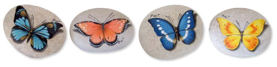Farfalle dipinte sui sassi